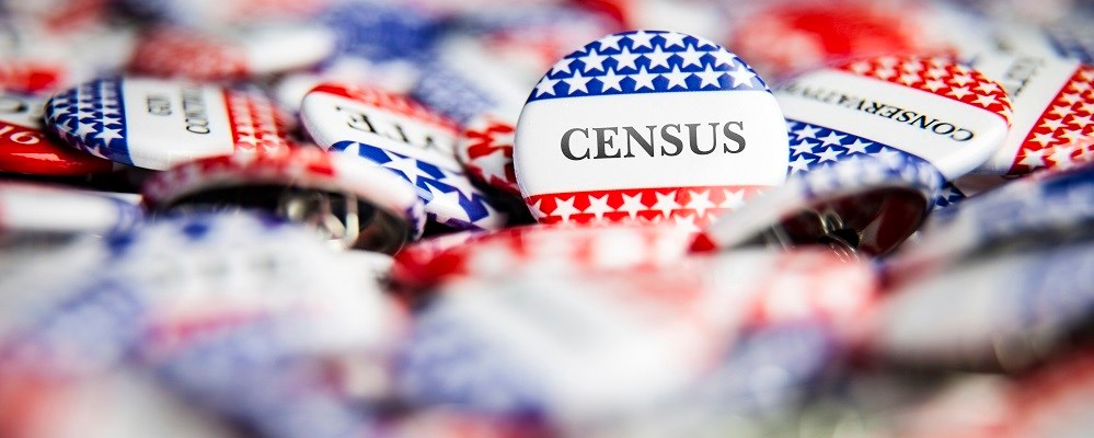 Closeup of button with text that says Census.