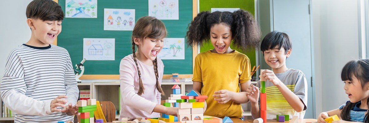 ImageChildren playing with blocks in a classroom.