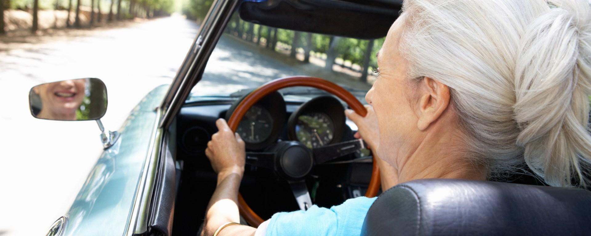 Senior driving a convertible.