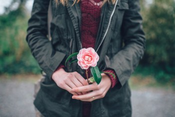 Woman giving a gift of a flower