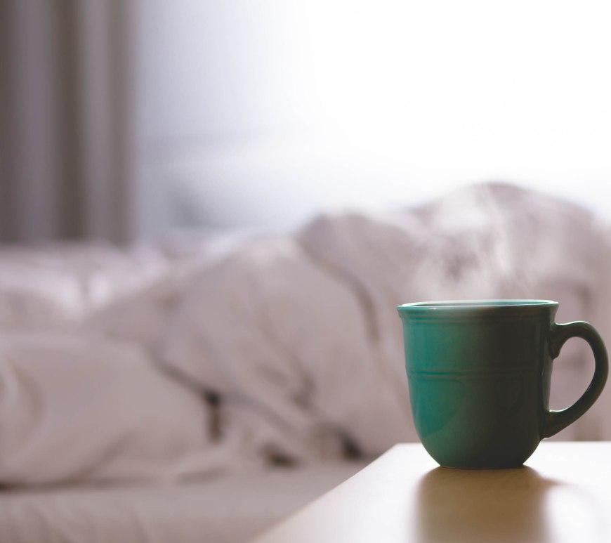 Coffee cup on nightstand.