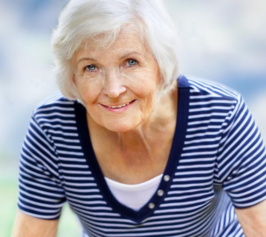 Woman smiling.