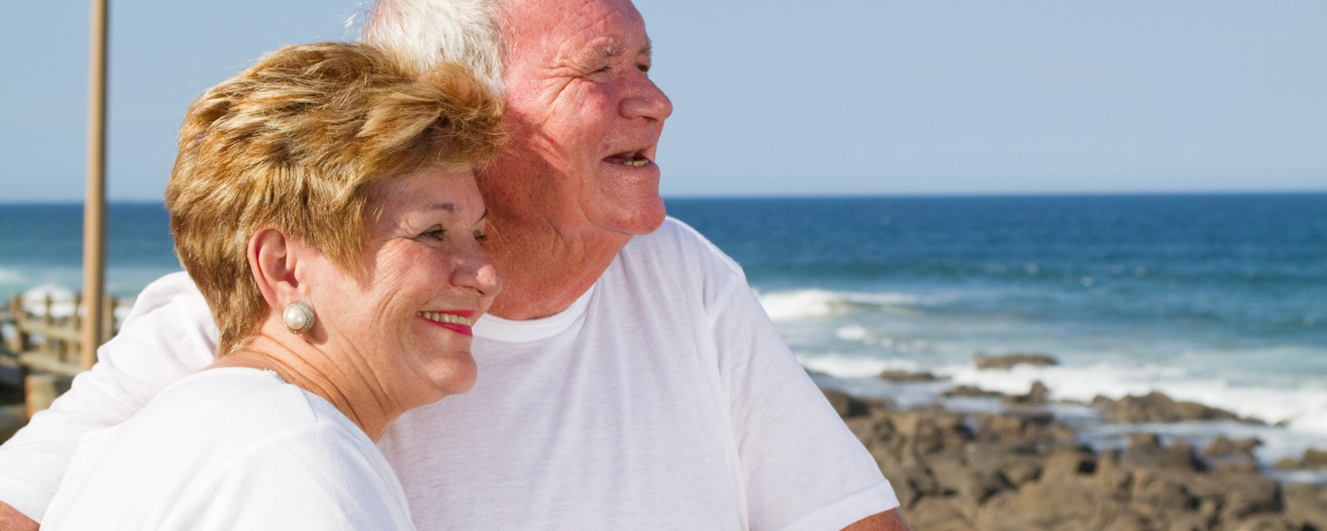 Couple smiling at beach.
