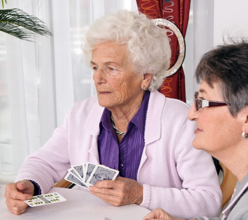 Women playing cards.