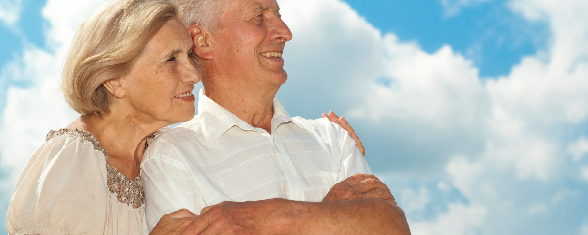 Man and woman hugging and smiling.