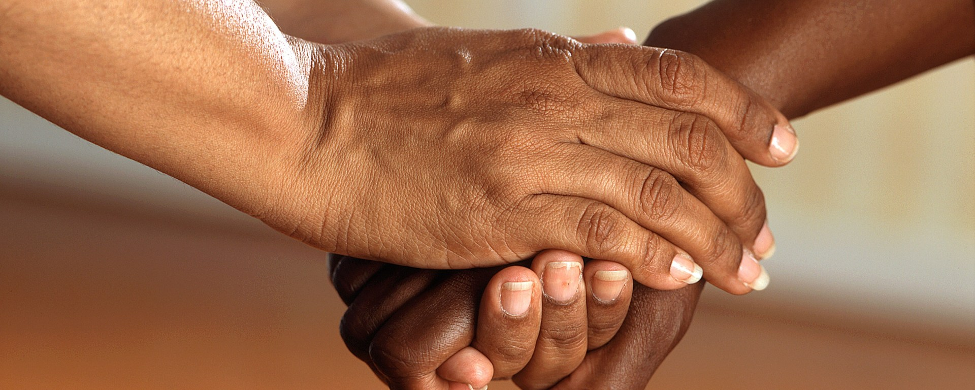 Two people clasping hands.
