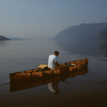 Peter Lourie reflecting in Kayak on Hudson River