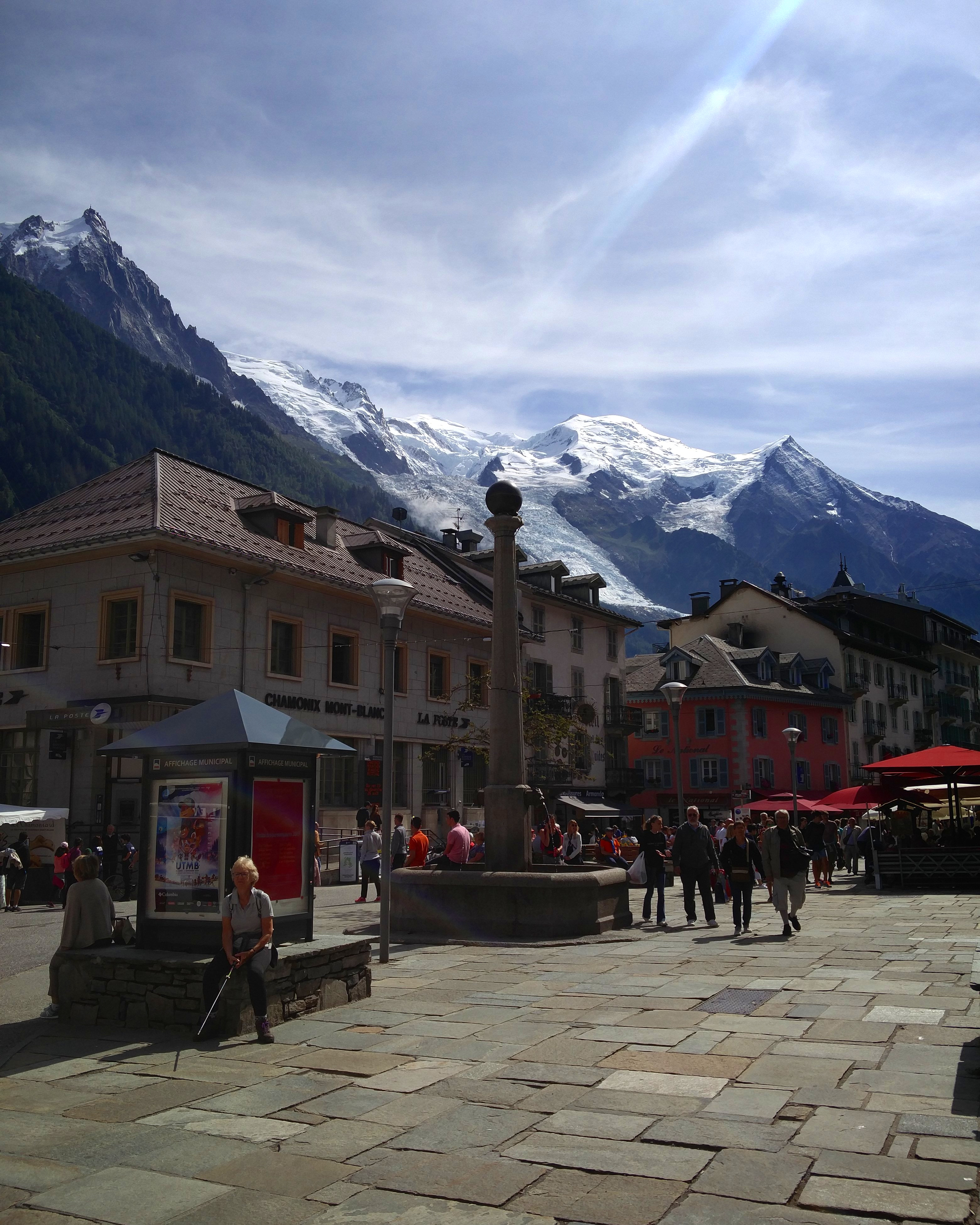 Centre of Chamonix Mont - Blanc. Main tourist street bustling with tourists, climbers, walkers and adventure enthusiasts.