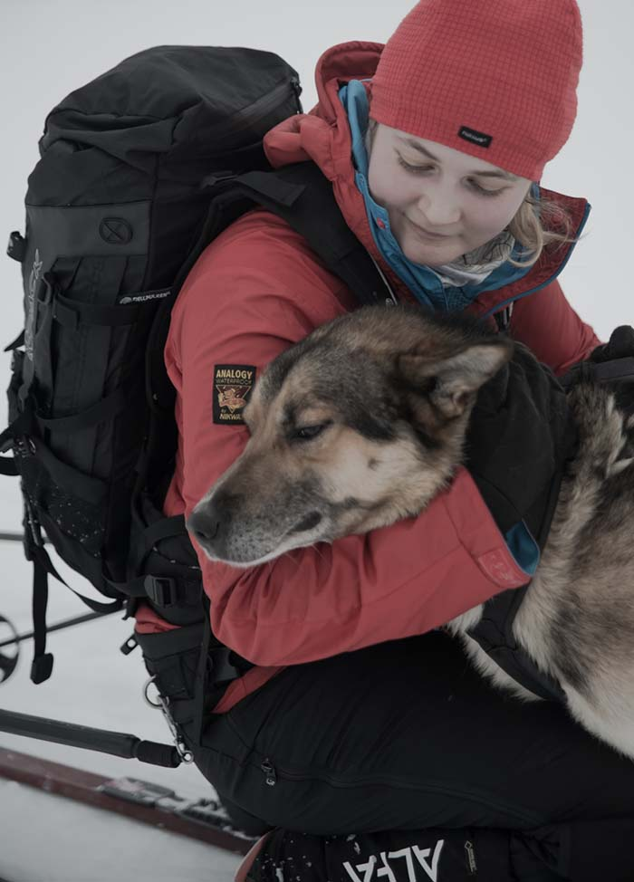 Adventurer, Lucy Shepherd, with an alaskan husky in the arctic