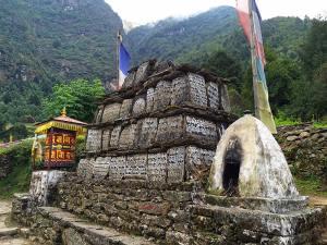 On the way to Phakding - Prayer wheels, prayer stones, and prayer flags