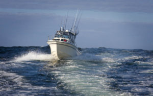 Fishing boat moving fast at sea, Adventure Marine