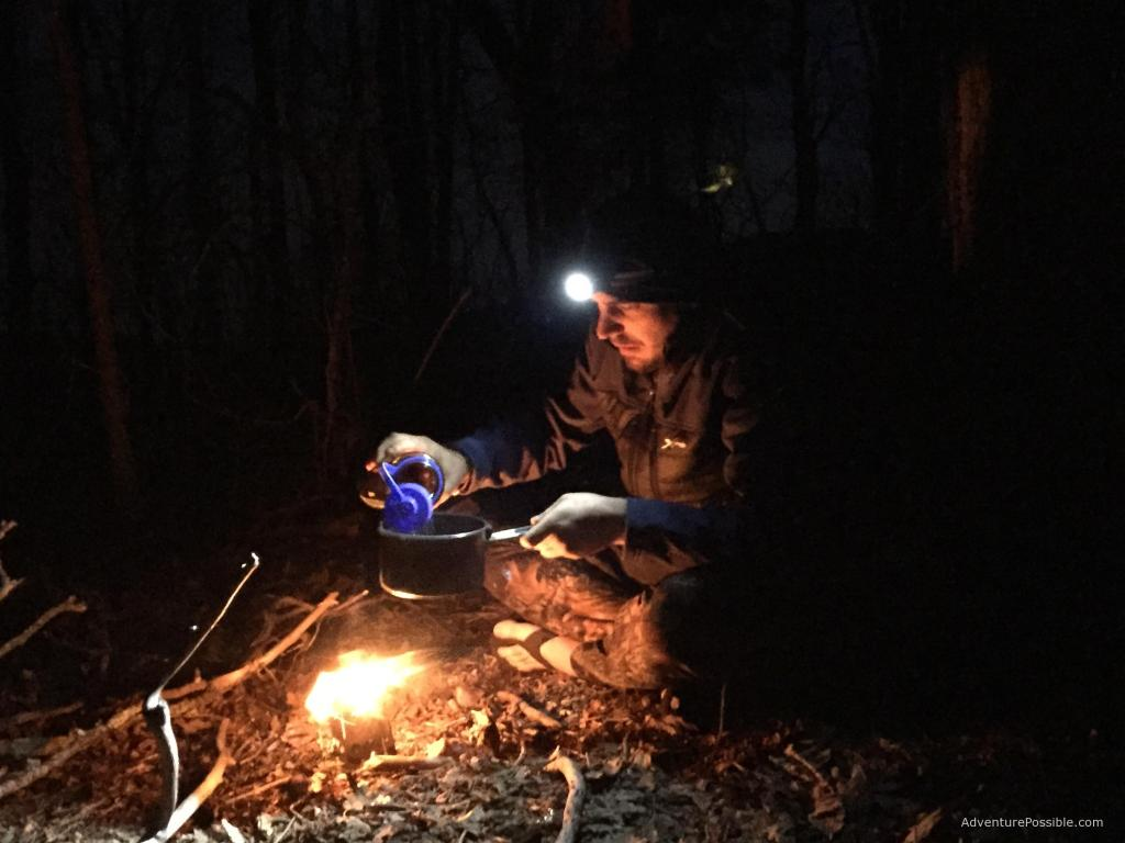 thru-hiker preparing dinner on appalachian trail