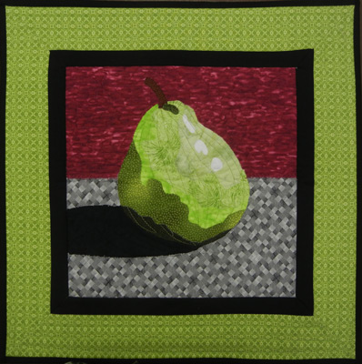 Made using Ellen Lindner's Double Reverse Applique technique. AdventureQuilter.com