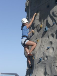 A girl climbs a rocking wall
