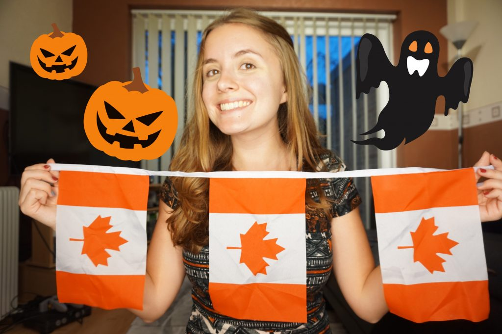 A girl smiling holding up Canada flags in her living room