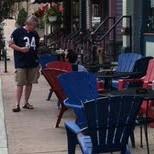 Beer bellied man walking down Brady Street enjoying his happy hour (10am) PBR