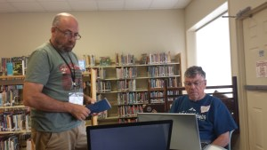 Rob and Bob Roehm scanning photos.
