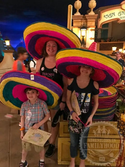 Kids trying on sombreros in Mexico Pavilion Epcot World Showcase