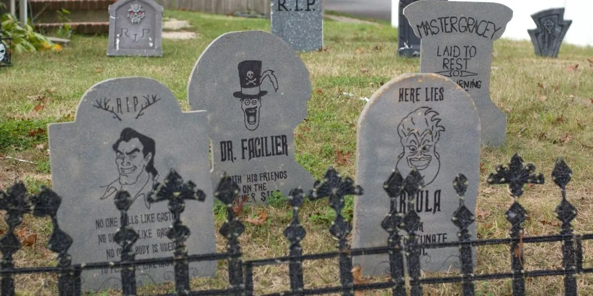 Halloween tombstones made from wood featuring Disney Villains Gaston, Ursula, and Dr. Facilier