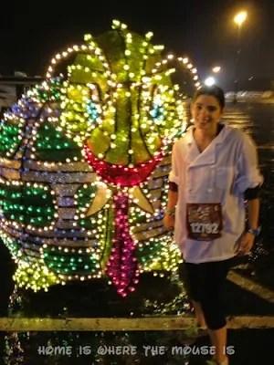 runDisney | Lisa poses with Light-up Float | Wine & Dine Half Marathon