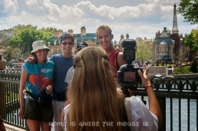 Disney's PhotoPass Photographer gets a group shot in Epcot