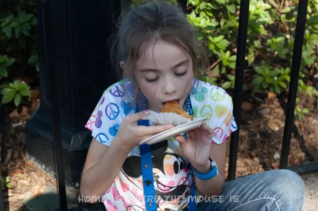 Bella tries Baklava for the first time at the Epcot International Food & Wine Festival