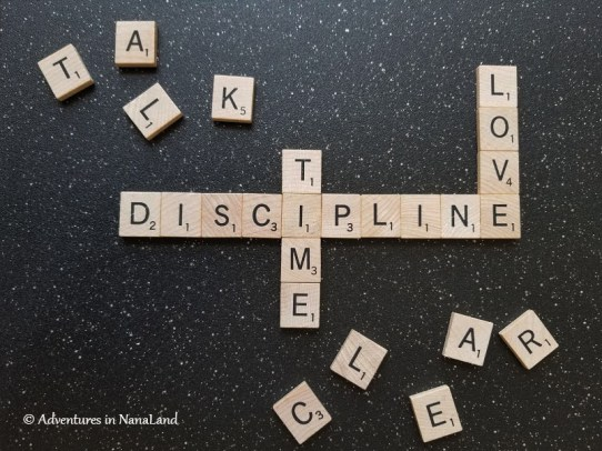 The words discipline, love, talk, clean, and time spelled out with scrabble tiles - Disciplining your grandchildren - Adventures in NanaLand