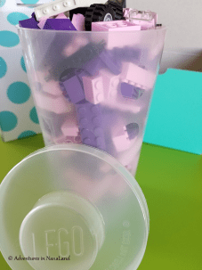 Plastic cup with LEGO lid with LEGO pieces inside - Legos for cheap - Adventures in NanaLand