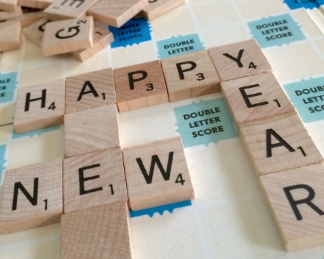 Scrabbles tiles spelling out Happy New Year - The secret to keeping your new near's resolutions - Adventures in NanaLand