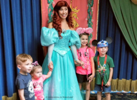 Kids at Disneyland posing with Aerial the Little Mermaid - Planning a Trip to Disneyland - Adventures in NanaLand