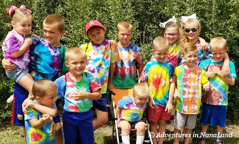 Group of kids in tie dye shirts - Grandma Camp Tips - Adventures in NanaLand