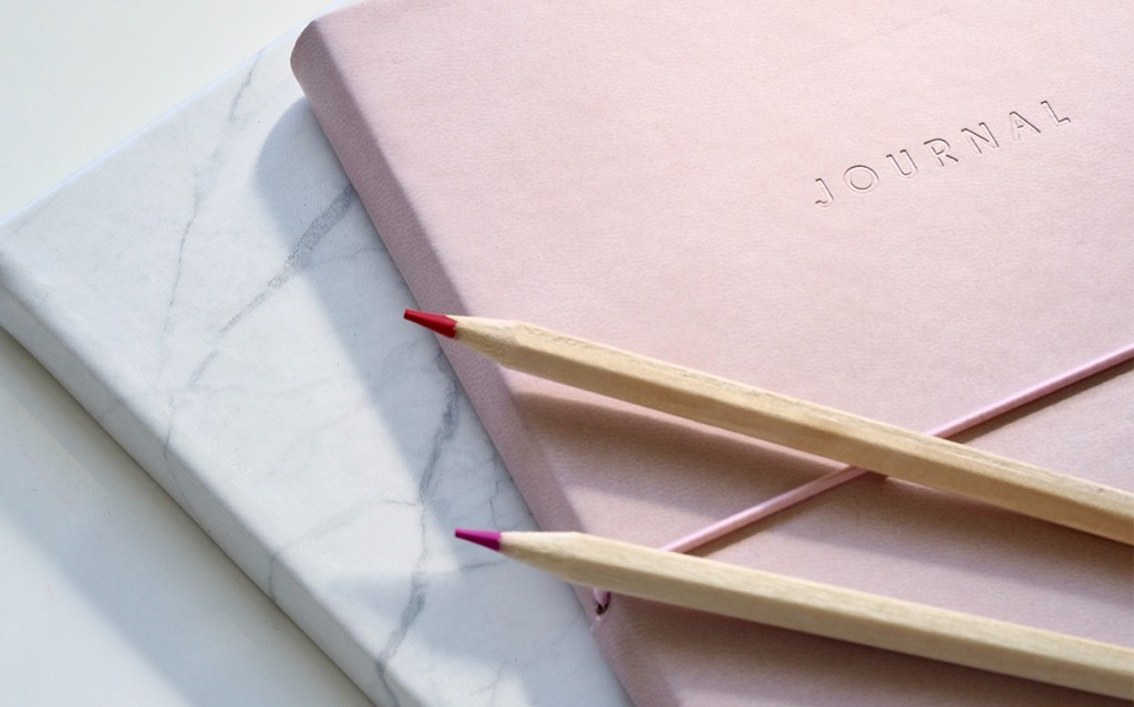 Pink journal with pink and purple colored pencils - Writing your life story - Adventures in NanaLand