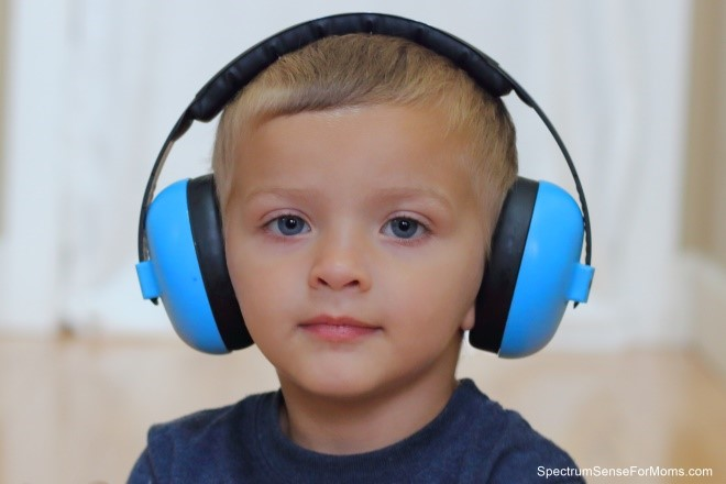 Boy with large blue headphones on - Special needs grandchildren - Adventures in NanaLand