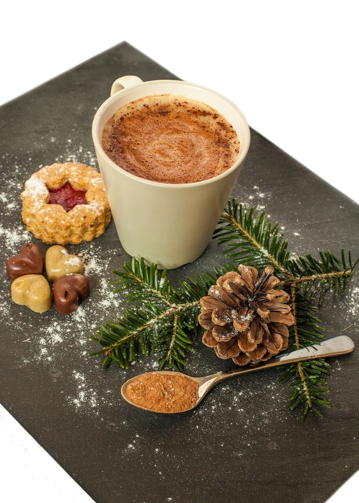 Cup of hot cocoa on cutting board with Christmas greenery - Fabulous Skinny Hot Cocoa - Adventures in NanaLand