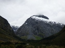 Snow on the mountains at the tunnel exit