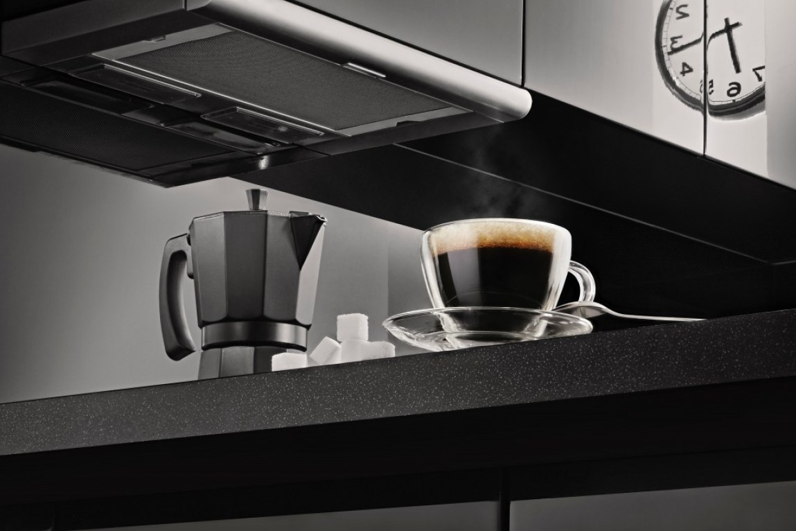 coffee pot and black coffee glass cup in kitchen