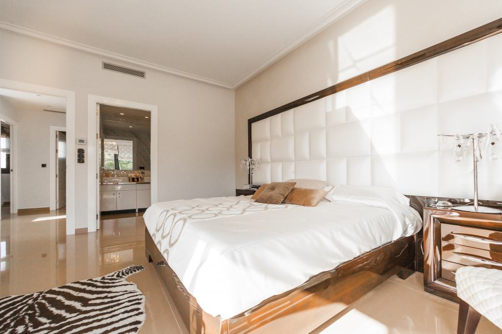 luxury bedroom with white interiors