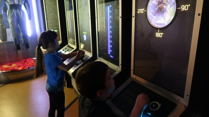 children using interactive exhibition at spaceport