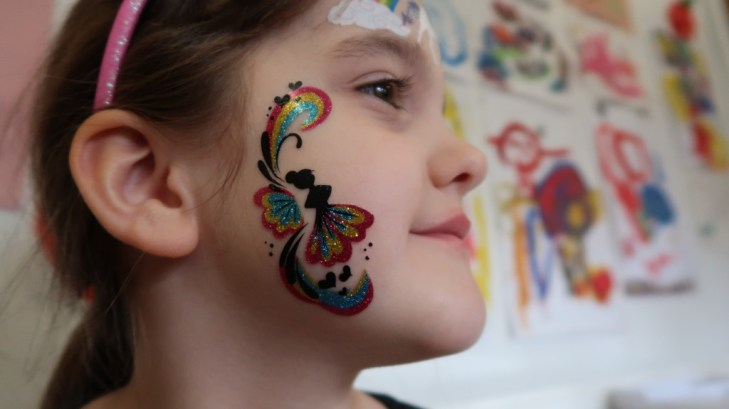 girl with temporary fablab face tattoo on cheek