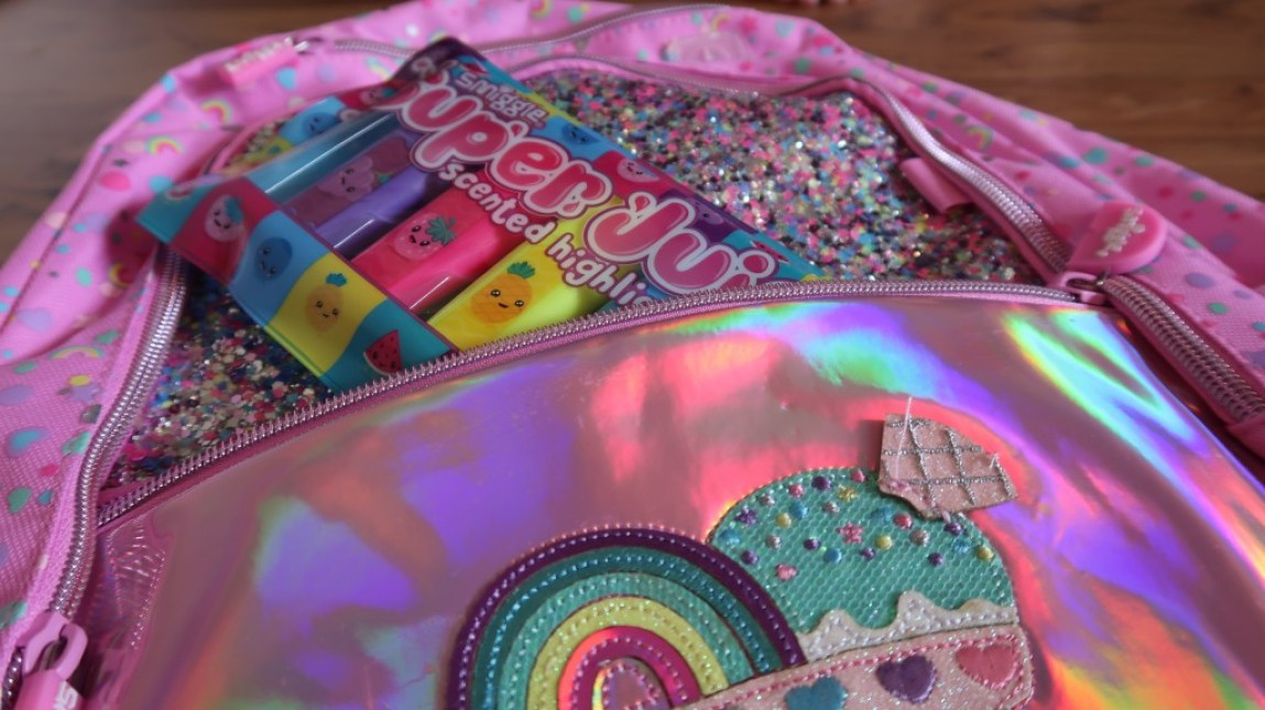 super juicy highlighter pack peeping out of sparkly pink smiggle backpack
