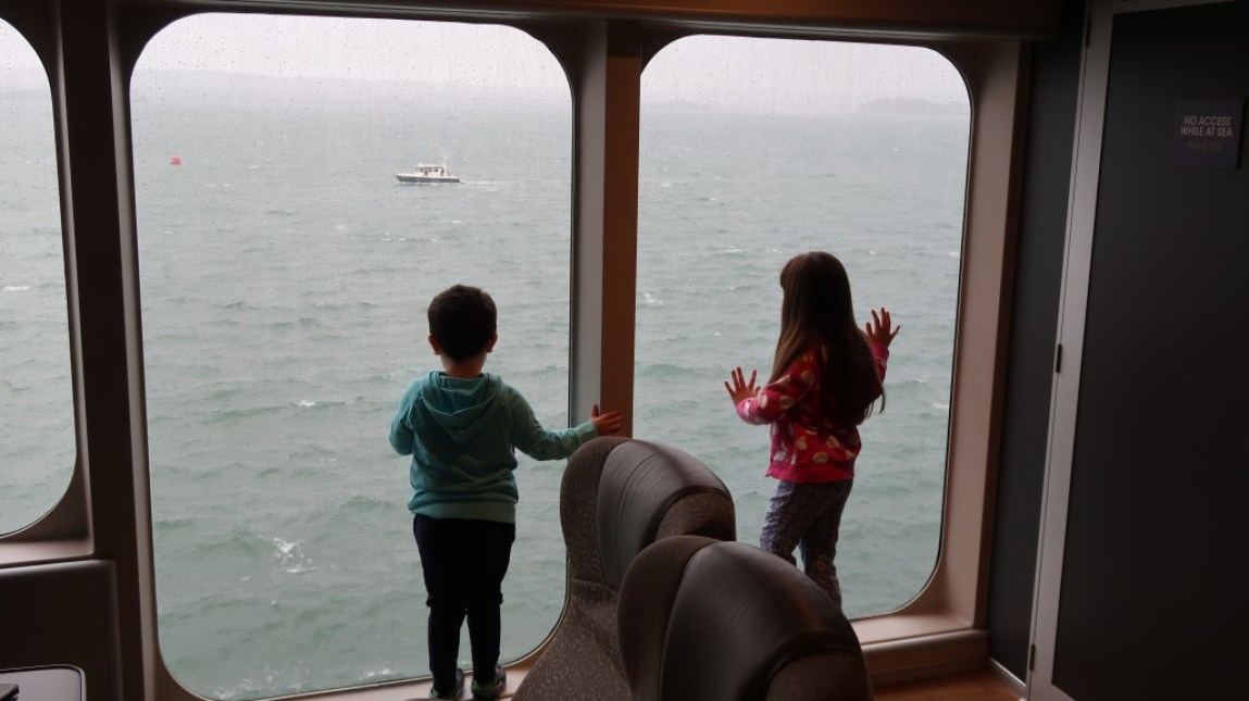 children looking out to sea from ocean club lounge The Condor Liberation condor ferries