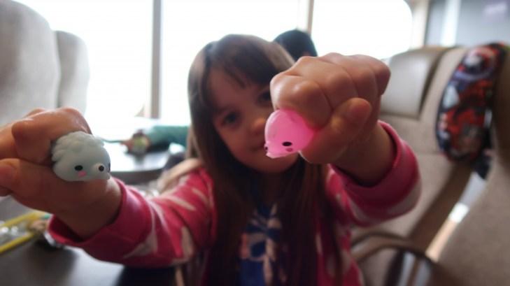 girl squishing moj moj surprise toy