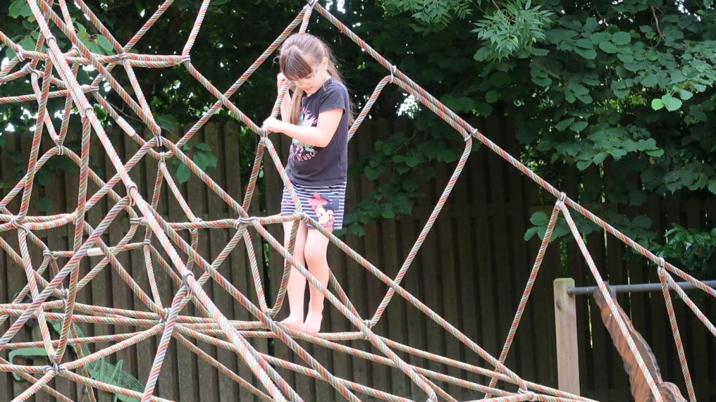 girl climbing on play area at jersey zoo