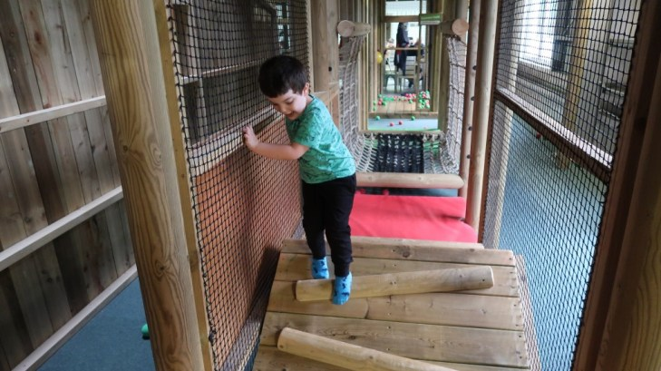 boy climbing through aMaizin! adventure park jersey