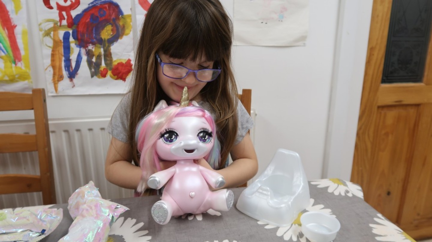 girl holding poopsie unicorn