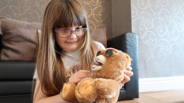 girl with glasses looking at feisty pets scary face