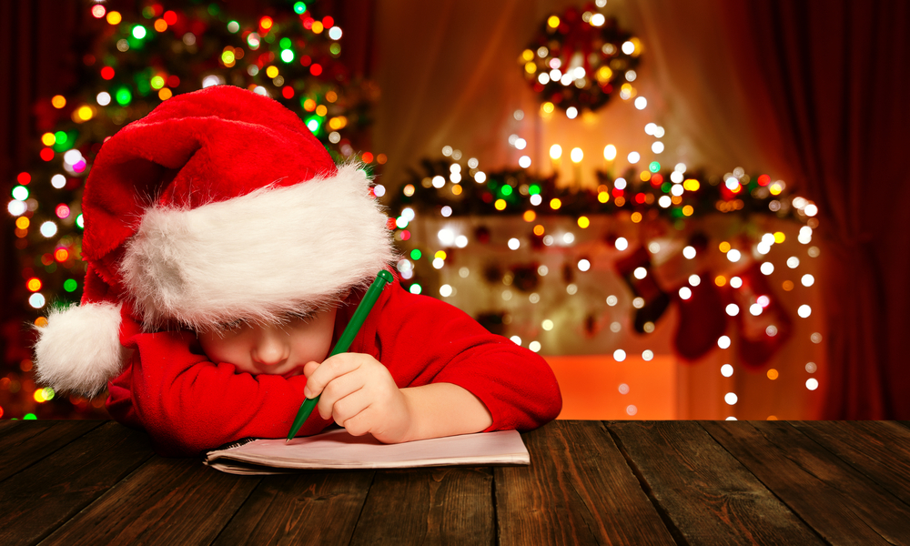 kids with santa hat writing a letter to santa