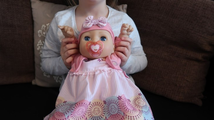 girl holding baby annabell my special day doll