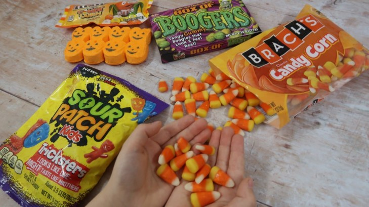 child hold candy corn from taffy mail subscription box