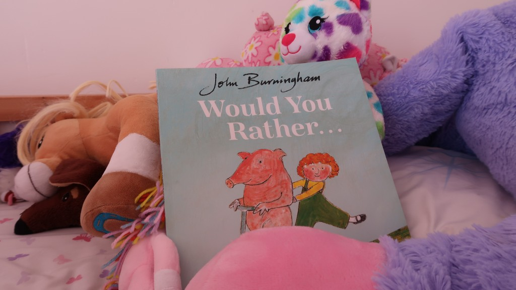 kids book on a bed with soft toys